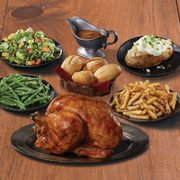 Swiss Chalet: Get a Family Pak with a Whole Rotisserie Chicken, Four Sides and Four Dinner Rolls for $25.00, Take-Out Only
